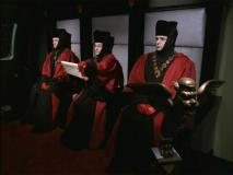 Judge Q accompanied by two other judges in Star Trek: Voyager. from the