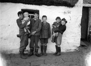 The Ó Súilleabháin family from Baile an Tobair, Co. Galway. Photograph by Leo Corduff, 1955