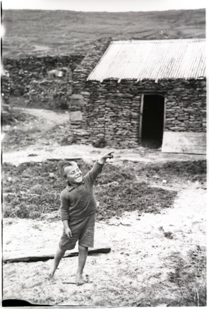 Small boy at play. Photographer Tomás Ó Muircheartaigh.