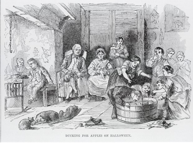 'Ducking For Apples on Halloween', from Robert Chambers' 'Book of Days', 1864